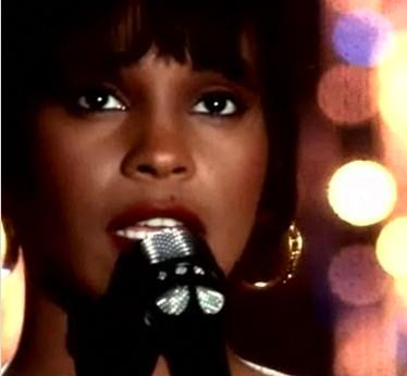 "Whitney Houston, singing ""I Will Always Love You"" in her video of the same name"